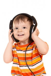 smiling baby with headphones